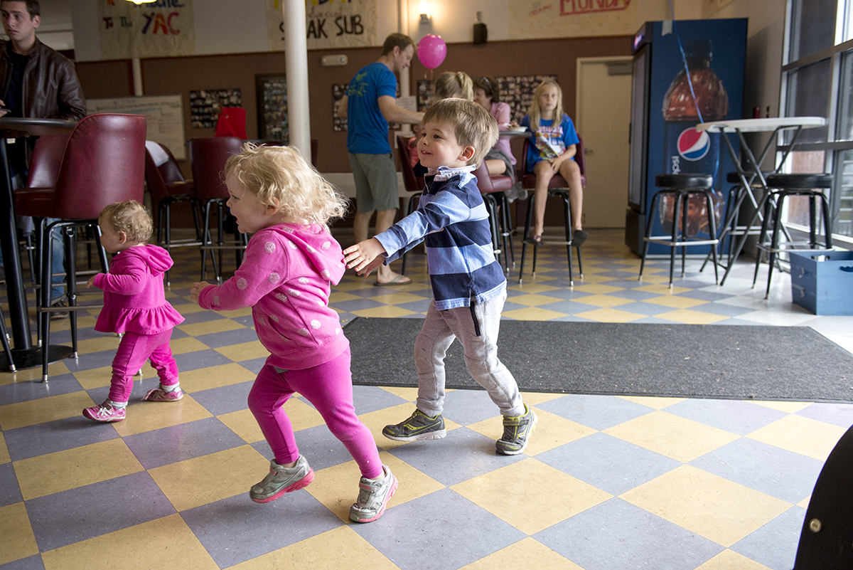 Graham Lockwood, 3, chases his sister, Cassie Lockwood, during the the 2016 Summer Fest sponsored by the NOW Generation on July 30, 2016 in the Youth Activities Center. Photo by Sarah Holm
