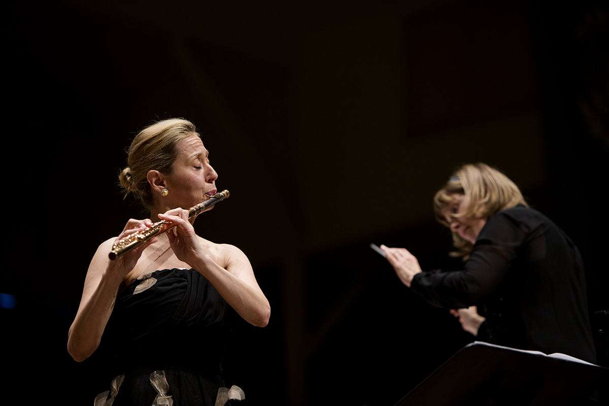 "Conductor JoAnn Falletta and flutist Marina Piccinini perform Romanian Rhapsody in A major, op. 11, no 1 (1901) August 4, 2016 in the Amphitheater.  Piccinini is a self taught flutist whose solo on a ""landmark"" concert, written especially for her, spans the entire range of the instrument. Photo by Eslah Attar"