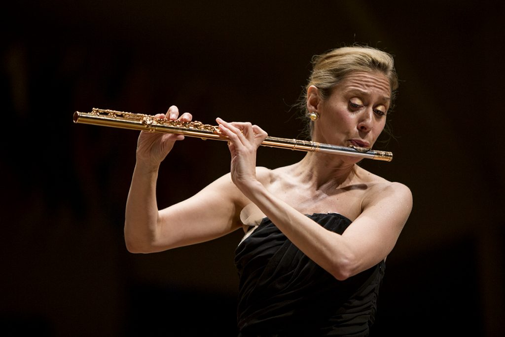 """Flutist Marina Piccinini performs with the Chautauqua Symphony Orchestra August 4, 2016 in the Amphitheater.  Piccinini is a self taught flutist whose solo on a """"landmark"""" concert, written especially for her, spans the entire range of the instrument. Photo by Eslah Attar"""