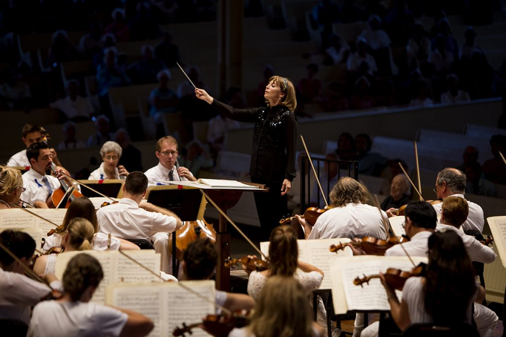 Conductor JoAnn Falletta leads the Chautauqua Symphony Orchestra in Romanian Rhapsody in A major, op. 11, no 1 (1901) August 4, 2016 in the Amphitheater. Falletta chose the song based on the it's origin as gypsy dance music that would be performed at celebrations. Photo by Eslah Attar