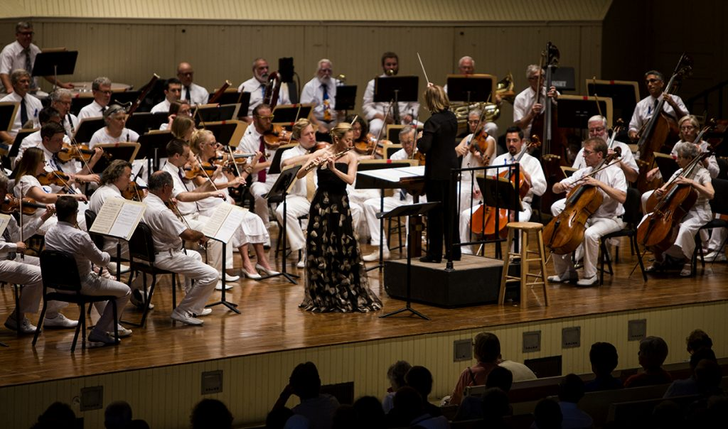 Conductor JoAnn Falletta and flutist Marina Piccinini perform Romanian Rhapsody in A major, op. 11, no 1 (1901) August 4, 2016 in the Amphitheater. Photo by Eslah Attar