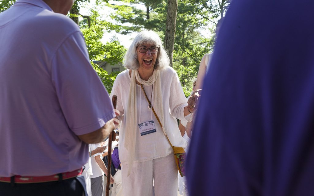 Tish Powers smiles as she reaches the top step leading into the Hall of Philosophy during the Chautauqua Literary and Scientific Circle Recognition Ceremony at 9:30 A.M. on Wednesday, August 3, in the Hall of Philosophy. The 121 new members of the CLSC Class of 2016 who were present at the ceremony heard songs by the Chautauqua Motet Choir as well as applause from previous graduates, friends, and family. Photo by Carolyn Brown.