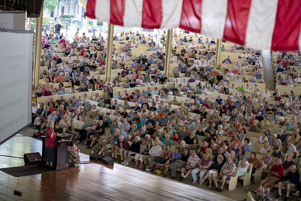 """Saskia Sassen, a professor of sociology at Columbia University, delivers her lecture """"Who Owns the City"""" on Aug. 5, 2016 in the amphitheater. Photo by Sarah Holm"""