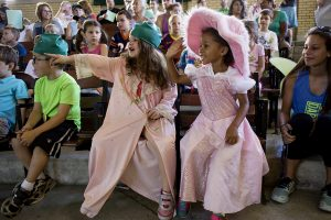 Left Tatum Bensink, 5, and Isabelle Dawson, 5, participate in the Troll Play presented by the Children's School August 2, 2016 in Smith Wilkes Hall. The Troll Play has become an Old First Night tradition for Chauatquans. Photo by Eslah Attar