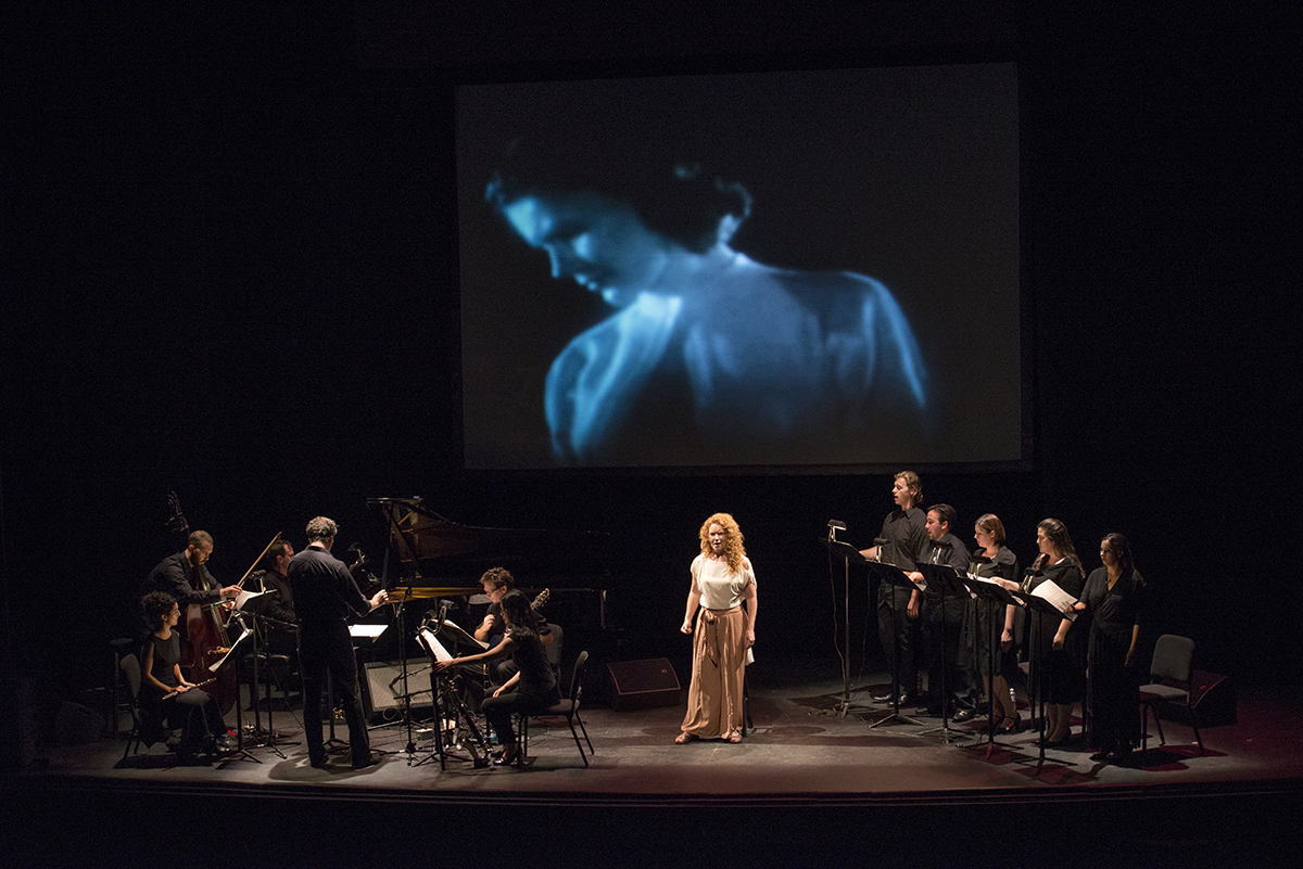 "Abigail Fischer, as Isabelle,  performs with a vocal ensemble of opera young artists and the NOW Ensemble in ""Songs From the Uproar"" on Aug. 8, 2016 in Norton Hall. The concert combined music with film. Photo by Sarah Holm"