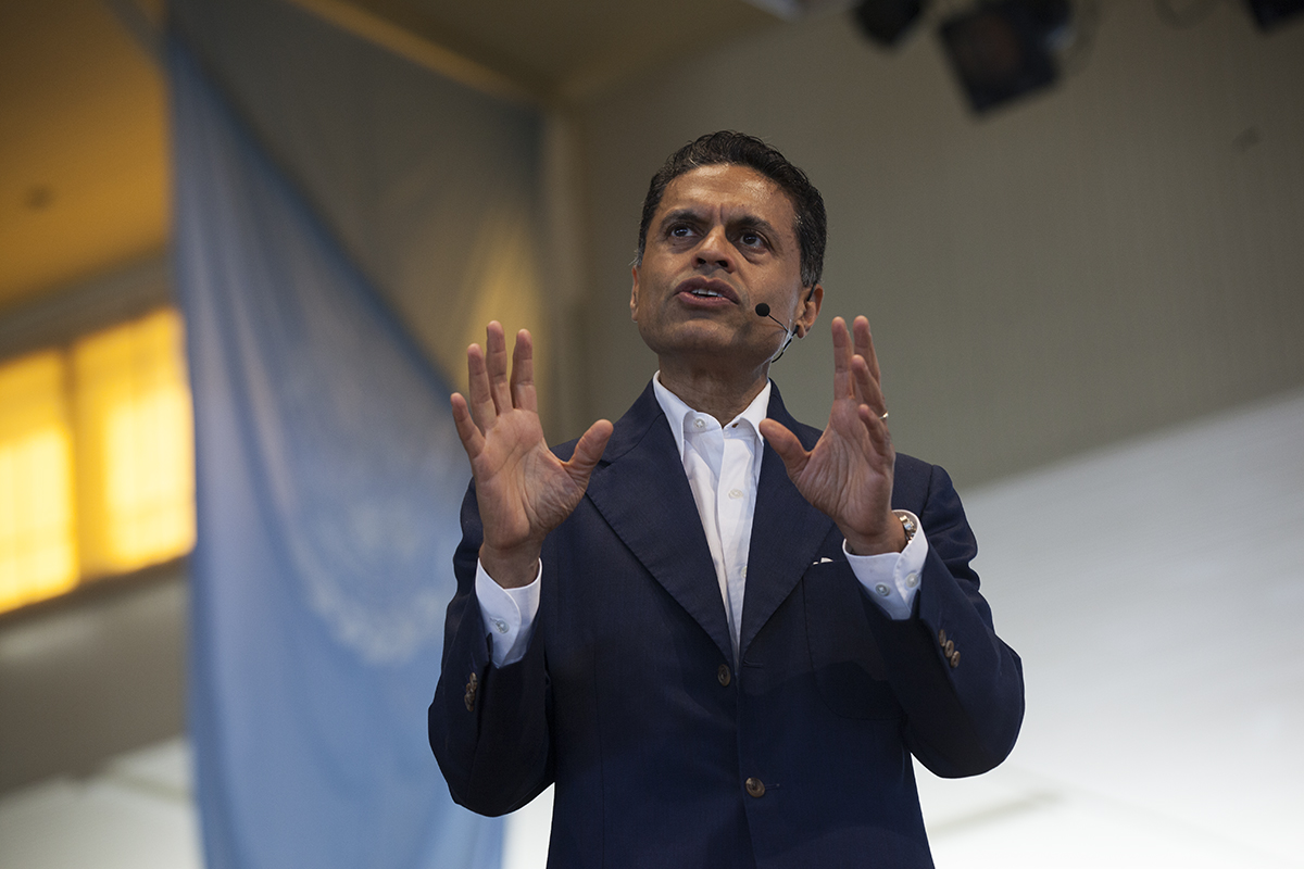 "Journalist Fareed Zakaria speaks during his 10:45 morning lecture on Tuesday, August 9, 2016, at the Amphitheater. Zakaria discussed the impact of technology on the American economy. Referring to the United States's complicated policies and practices relating to outsourcing, employment, and trade, Zakaria said, ""We're the cleanest dirty shirt in the laundry pile."" Photo by Carolyn Brown."