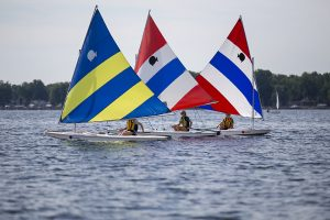 Students in the teen sailing class sail Sunfish sailboats July 20, 2016, at the Turner Sailing Center. Photo by Mike Clark