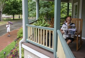 "John Burke plays the accordion as part of the special studies class, ""Jamming at Chautauqua"" led by Suzanne Shull, on Aug. 5, 2016 on the porch of the St. Elmo. Photo by Sarah Holm"