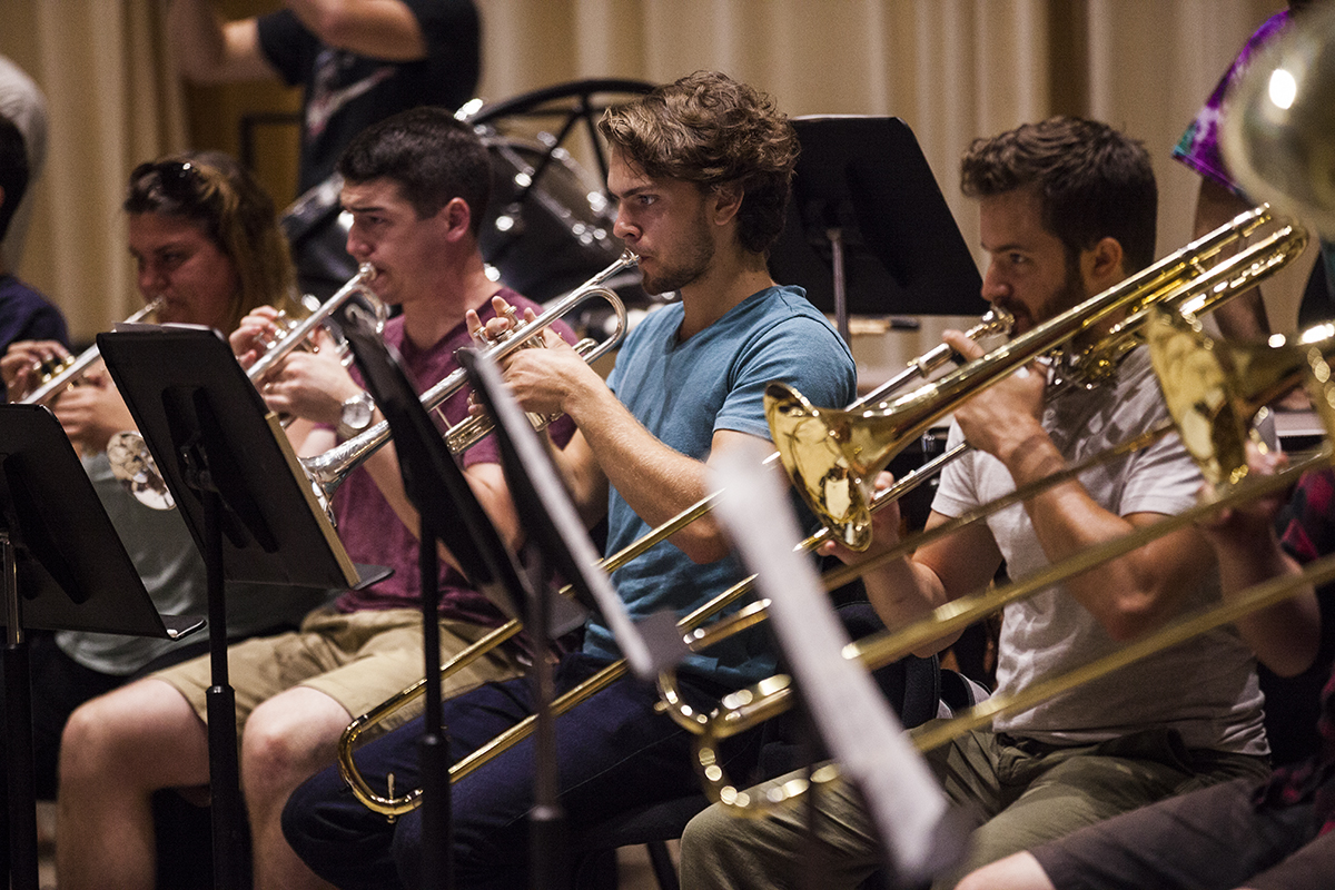 Student musicians in the horn section of the Music School Festival Orchestra rehease for their upcoming concert at 11 AM on Saturday, August 13, 2016, in Lenna Hall. The MSFO students will perform at 8:15 P.M. on Monday, August 15, 2016, in the Amphitheater. Photo by Carolyn Brown.