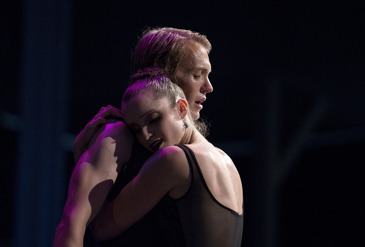 "James Kopecky and Chelsea Dumas embrace while dancing to ""You and I"" with choreography by Sasha Janes during the Charlotte Ballet's performance, Dance Innovations, on Aug. 3, 2016 in the Amphitheater. Photo by Sarah Holm"
