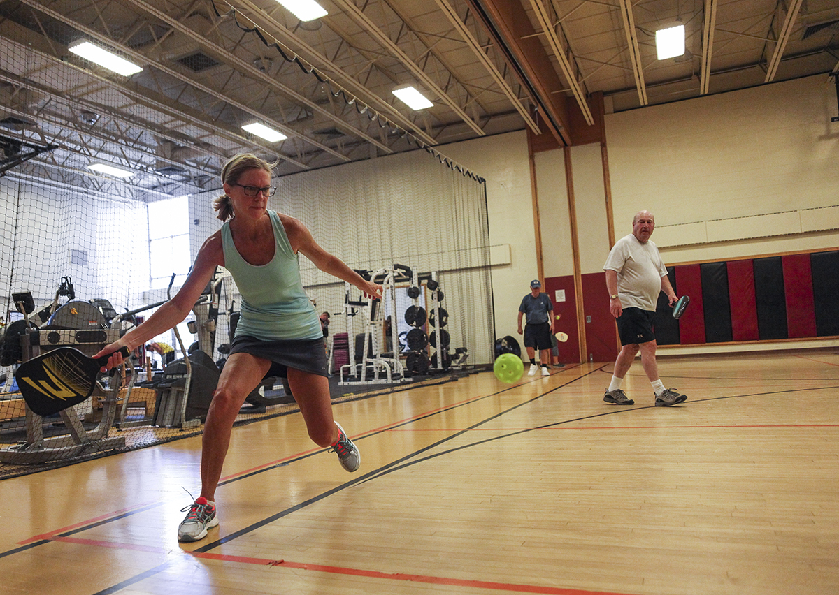 Margaret Dietly, left, plays pickleball with Don Shaffer, right, at noon on Friday, August 12, 2016, at Turney Community Center. Pickleball is a sport that is similar to tennis, but it uses a wiffle ball instead of a tennis ball. Photo by Carolyn Brown.