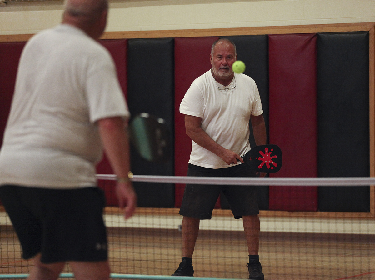 Don Shaffer, left, plays pickleball with Cam Morton, right, at noon on Friday, August 12, 2016, at Turney Community Center. Pickleball is a sport that is similar to tennis, but it uses a wiffle ball instead of a tennis ball. Photo by Carolyn Brown.