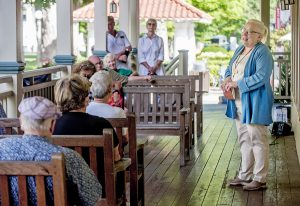 Vice President of Education and Youth Services Sherra Babcock talks about the week's programming during a Board of Trustees porch chat Aug. 17, 2016 on the Hultquist Center porch.