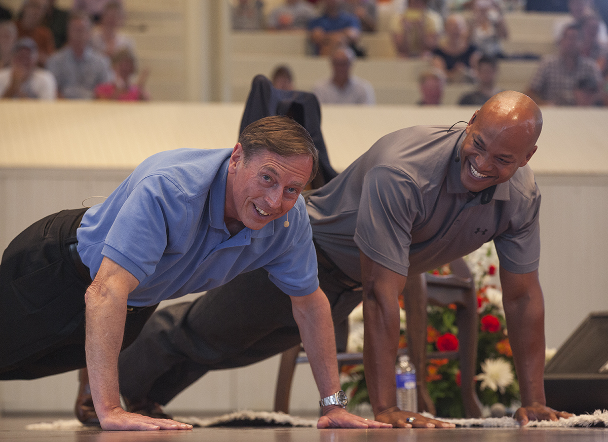 "Gen. David Petraeus, left, does the ""22 Pushup Challenge"" with Wes Moore, executive producer and host of PBS's ""Coming Back with Wes Moore,"" right, at 10:45 A.M. on Thursday, August 18, 2016, in the Amphitheater.The 22 Pushup Challenge is designed to raise awareness of suicides by military veterans. Moore asked Gen. Petraeus how many pushups he could do, and Gen. Petraeus responded, ""One more than you!"" Photo by Carolyn Brown."