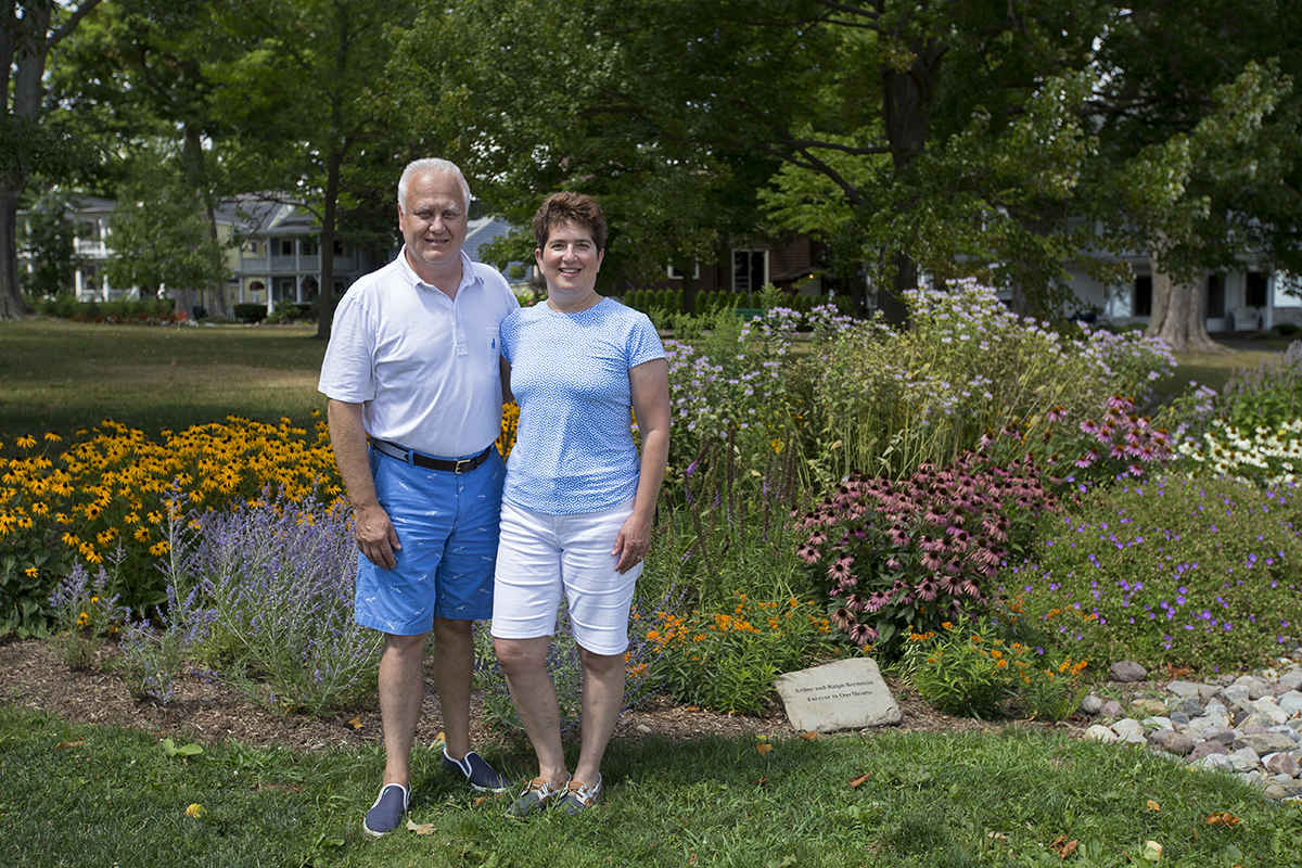 Marc Fultz and Ellen Fultz stand in front of the Arline and Ralph Bernstein Memorial Rain Garden. Established in memory of Ellen's parents, the Fultz's gift will help ensure sustained and natural ecological growth within Chautauqua Institution. Photo by: Mike Clark
