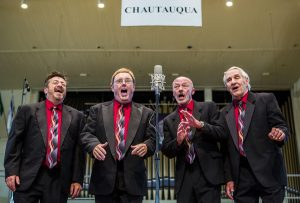 The quartet Geezer Q performs during the 2015 Chautauqua Barbershop Harmony Parade in the Amphitheater on August 23, 2015.