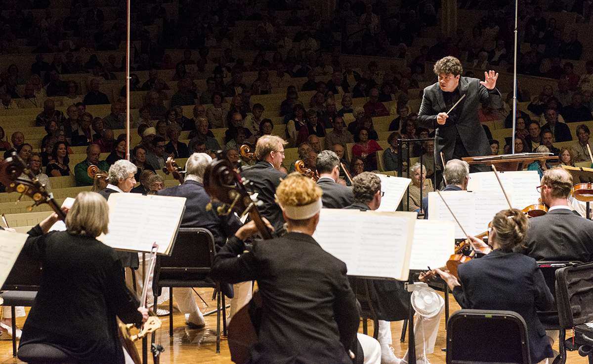"Guest conductor Cristian Macelaru leads the Chautauqua Symphony Orchestra's rendition of ""Variations Concertantes"" by Alberto Ginastera on Saturday, August 22, 2015."
