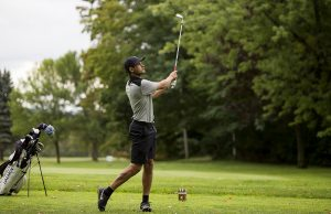 Jake Yartz tees off at the sixth hole in the Chautauqua Club Championship August 21, 2016. Yartz placed fist in the tournament with a final score of 141. Photo by Eslah Attar