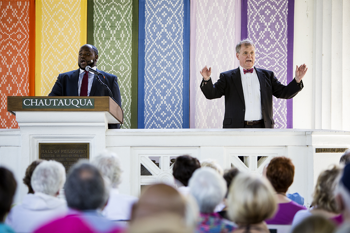 Steven Darsey, author, The God of Abraham, Isaac and Jacob: Music and Worship and tenor Timothy B. Miller demonstrate hymnody of camp meetings during afternoon lecture August 23, 2016 in the Hall of Philosophy. Darsey and Miller's lecture focused on the experience of a camp meeting, a Protestant Christian religious service popular during the Second Great Awakening in the early 19th century. Photo by Eslah Attar