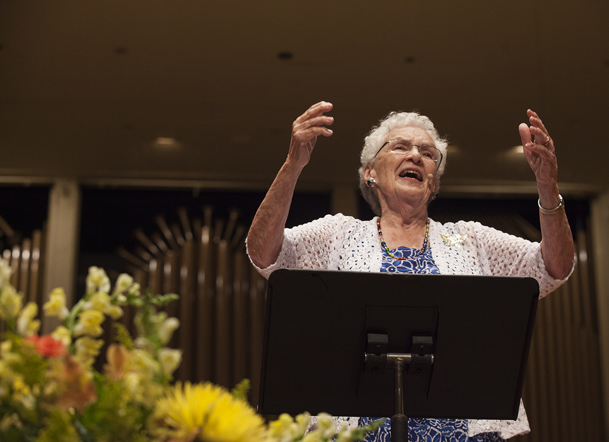 "Composer Alice Parker sings  during the Sacred Song Service at 8 P.M. on Sunday, August 21, 2016, in the Amphitheater. During the service, Parker also taught the audience a variety of hymns, including ""Swing Low, Sweet Chariot,"" ""Day is dying in the west,"" and ""Softly and tenderly, Jesus is calling."" Photo by Carolyn Brown."