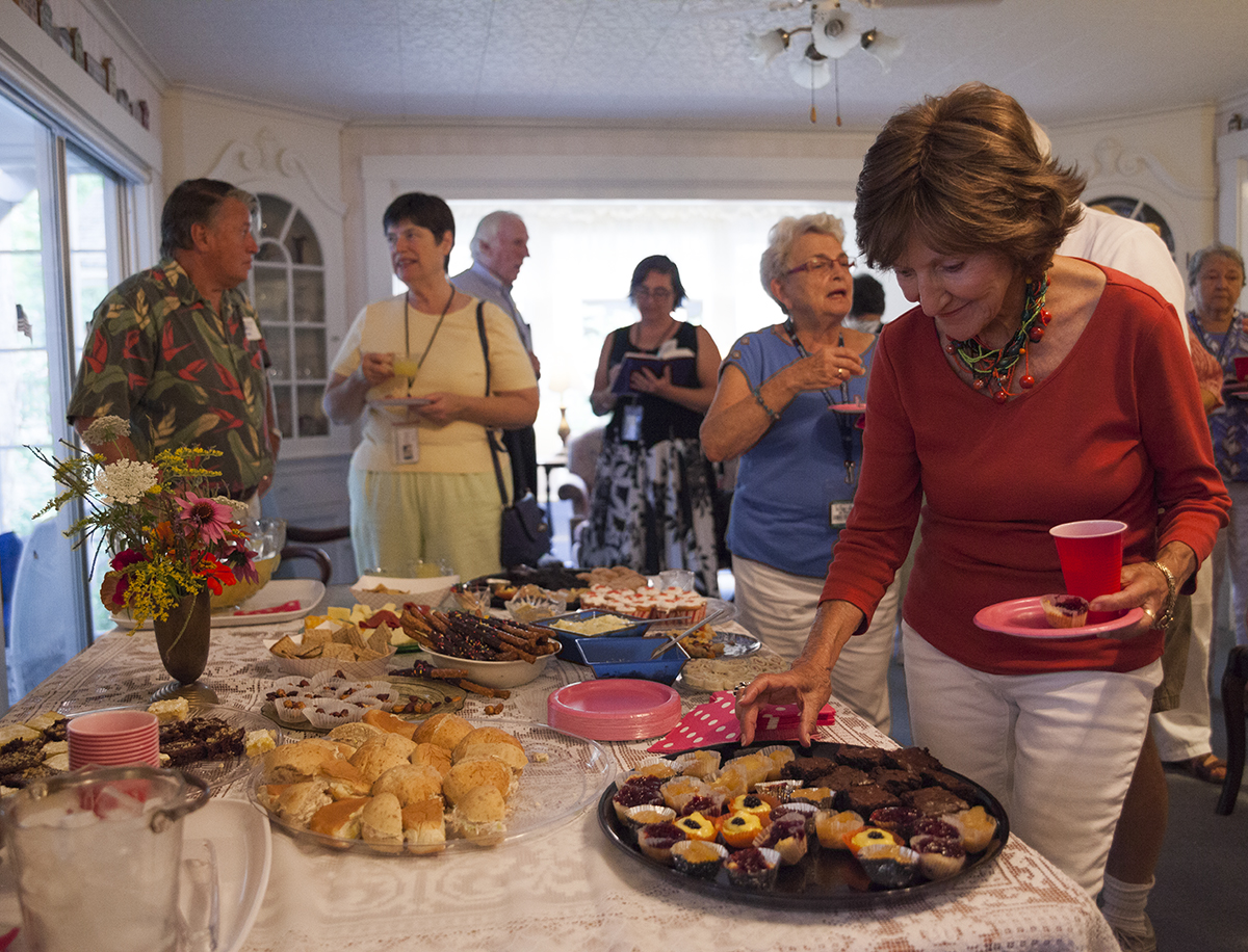 Rita Argen Auerbach, right, samples from the food trays as part of Social Hour at the Denominational Houses at 3:15 P.M. on Tuesday, August 9, 2016, at the Episcopal House. Auerbach, an Episcopalian, is an artist who is known around the grounds for her paintings of Chautauqua. Photo by Carolyn Brown.