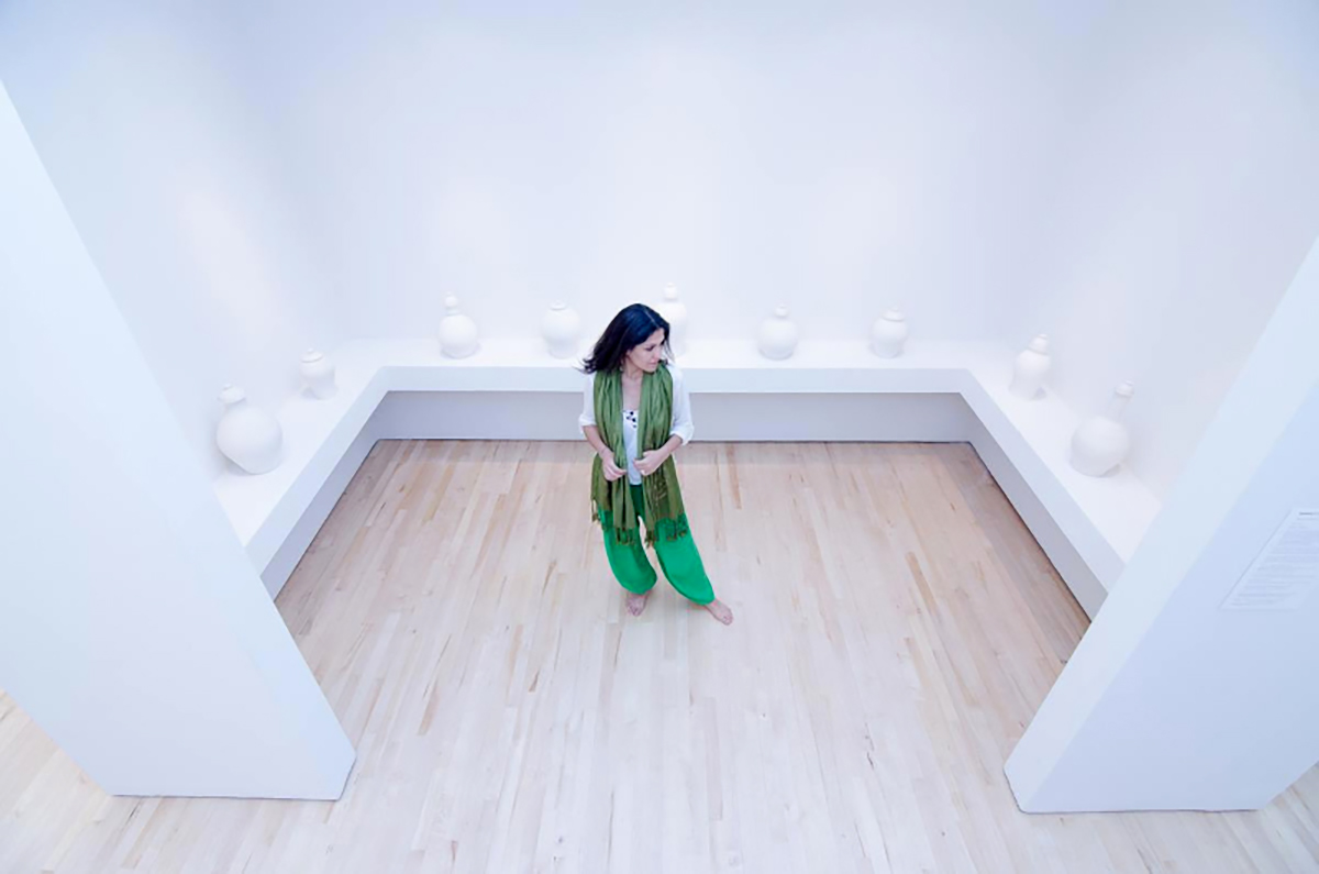 Raheleh Filsoofi stands with her installation piece _Only Sound Remains,_ 2014_