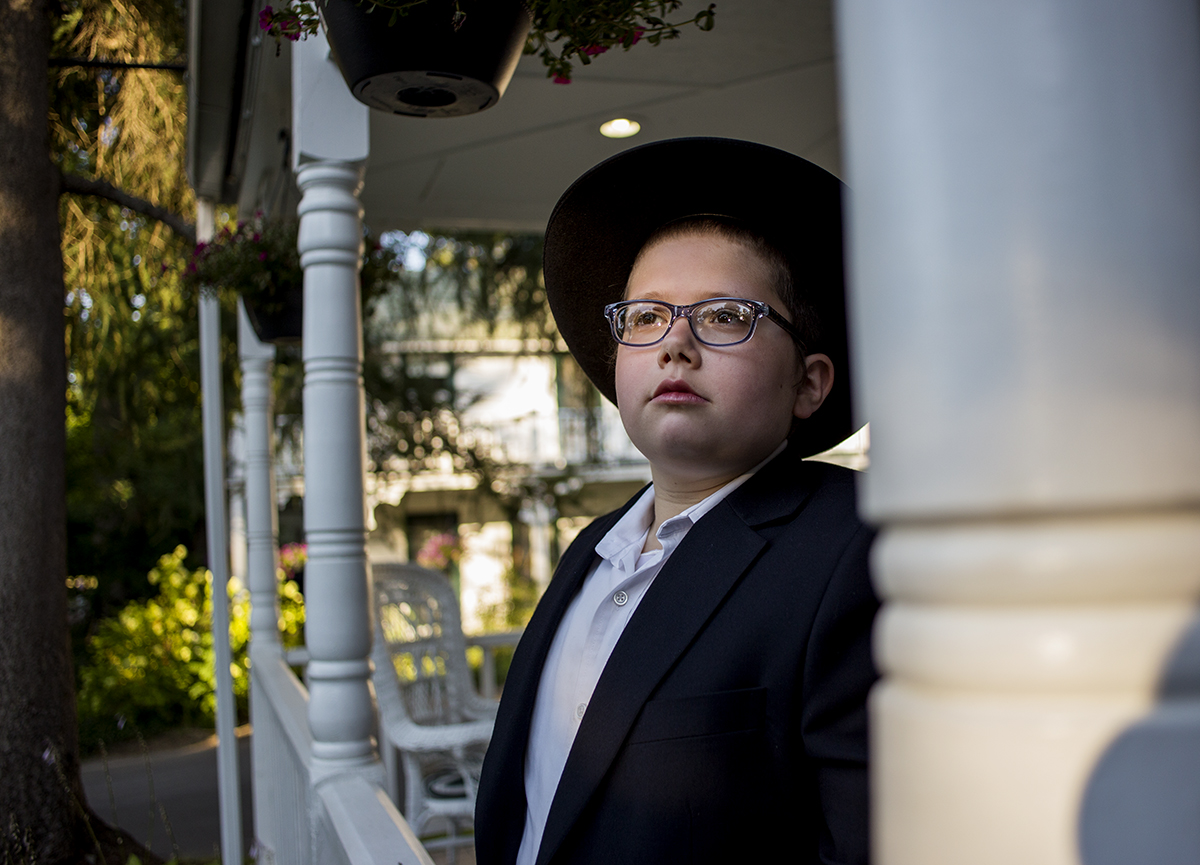 Shmuel Vilenkin, 12, stands outside the Chabad Lubavitch house August 2, 2016.